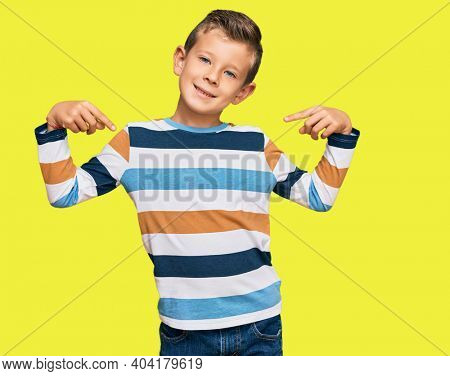 Adorable caucasian kid wearing casual clothes looking confident with smile on face, pointing oneself with fingers proud and happy.