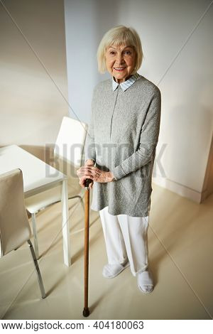 Joyous Aged Lady With A Cane Looking Ahead