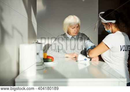 Serious Female Pensioner Undergoing A Routine Check-up