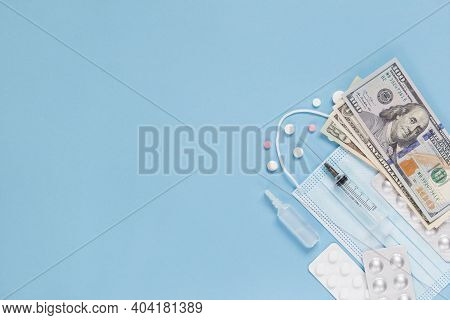 Medical Face Mask, Packaging With Pills, Expendable Syringe And Paper Money. The Concept Of Insuranc