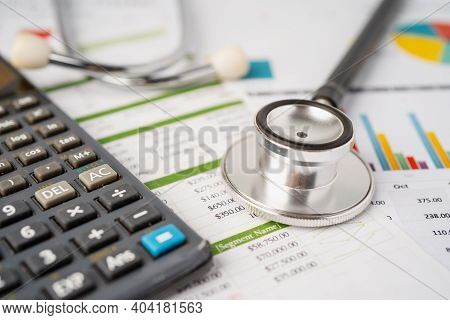 Stethoscope On Calculator, Finance, Account, Statistics, Analytic Research Data And Business Company