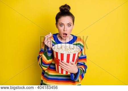 Photo Of Young Woman Amazed Surprised Shocked Eat Pop-corn Watch Thriller Movie Isolated Over Yellow