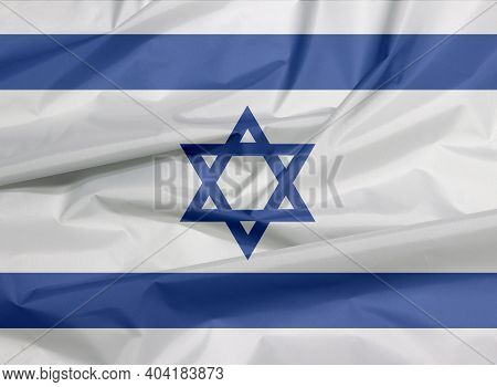 Fabric Flag Of Israel. Crease Of Israeli Flag Background, Blue Hexagram On A White Background, Betwe