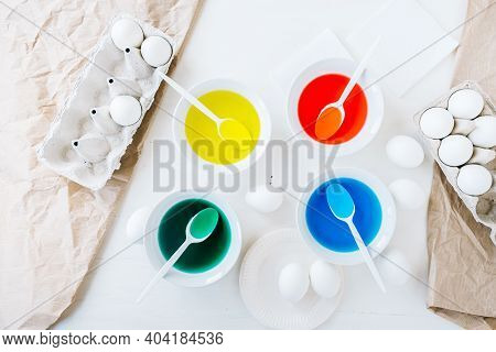 Preparing For Dyeing Easter Eggs With Liquid Food Coloring. Different Colors In Different Bowls, Egd
