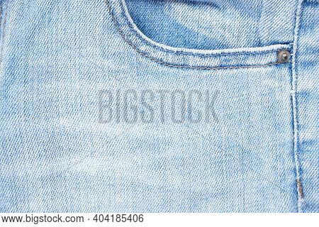 Denim Texture Of White Jeans Background, Classic Jeans. Blue Jeans Front Pocket.