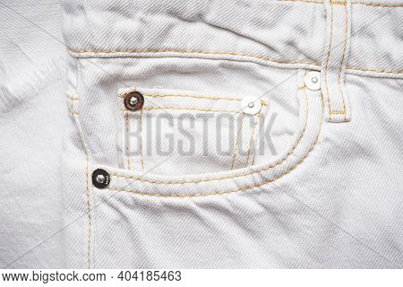 Denim Texture Of White Jeans Background, Classic Jeans. White Jeans Front Pocket.