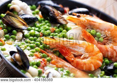 Pan-fried Seafood With Peas. High Quality Photo.