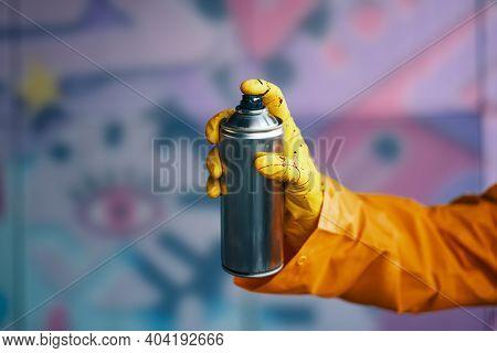 Graffiti Artist Pointing Spray Paint Can To Camera. Urban Street Modern Art Concept