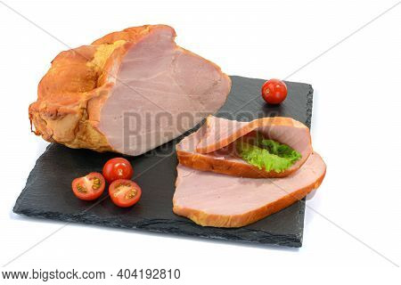 Sliced Smoked Pork Loin With Tomatoes On A Stone Plate, Isolated On A White Background.