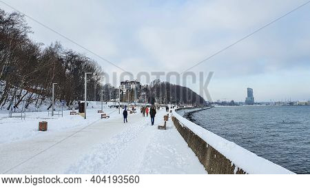 Gdynia, Poland - January 17, 2021: Winter Walk. People Walking On The Baltic Sea Boulevard In Gdynia