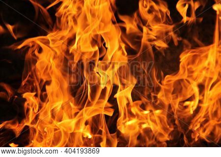 Abstract Blaze Fire Flame Texture Background.yellow Flame Isolated On Black Background