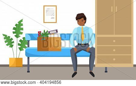 Unhappy Upset Young Office Worker Holds A Box With His Things And Leaves The Previous Office. Dismis