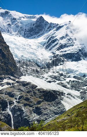 Rob Roy Glacier On The South Island Of New Zealand. Frozen Ice On A Mountain Of The Alps.
