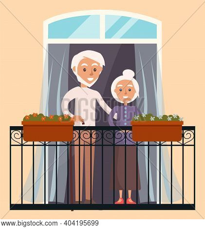 Elderly People In Love Resting At Home. Couple Looks Out The Window On The Balcony Of House. Citizen