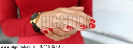Girl In Red Clothes Shows Hands With Red Manicure. Office Employee Submits A Report