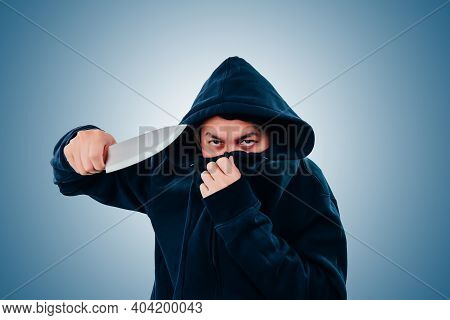 Robber, Bandit Or Thief Hold Knife On A Black Background.