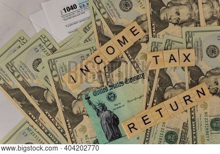 American Blank Tax Forms 1040 Estimated Tax For Individuals On Dollar Bill With Income Tax Return In