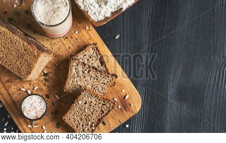 Leavened Bread, Whole Grain Rye Bread With Pumpkin And Sunflower Seeds. Leaven Starter On Table. Aut