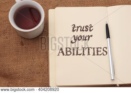 Trust Your Abilities, Text Words Typography Written On  Book Against Wooden Background, Life And Bus