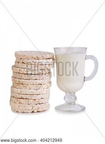 Glass and a bottle of milk and bread. Isolated object on white background