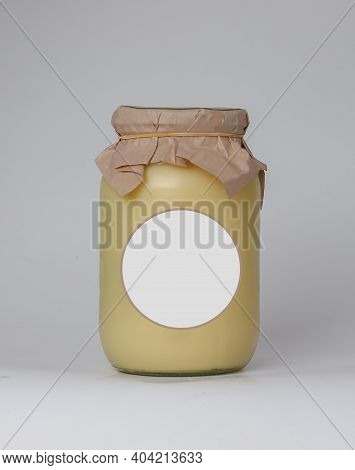 Tablespoon Of Ghee (clarified Butter) On A Background. Jar Mockup