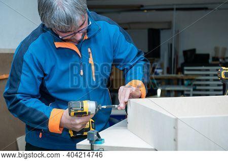 Handcrafting A Home Furniture. Senior Man Hobby Concept.