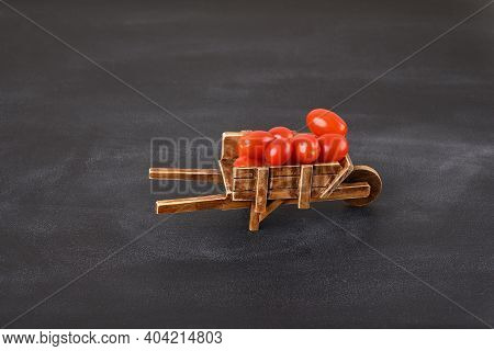 Full Of Antique Barrow With Cherry Tomatoes.