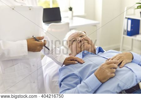 Supportive Doctor Talking To Senior Patient About His Diagnosis Or Admission To The Hospital