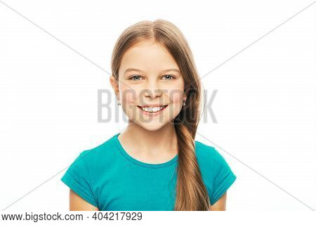Portrait Of A Beautiful Caucasian Girl With A White Healthy Smile, Isolated On White Background. Chi