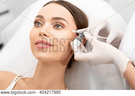 Injections Into The Eye Area. Facial Rejuvenation, Wrinkle Removal, Aesthetic Cosmetology