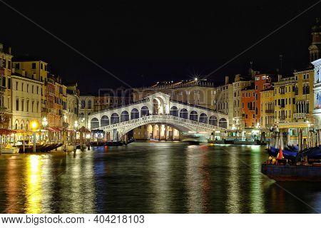 The Rialto Bridge By Night In Venice Italy