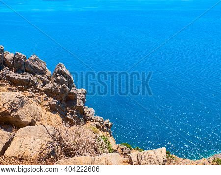Sheer Cliff Above The Sea. Sea And Sky Landscape With Copy Space