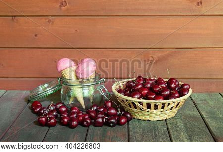 Cherry Sorbet Ice Cream In Waffle Cones And Fresh Cherry On Rustic Wooden Table. View With Copy Spac