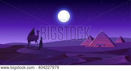 Bedouins Walk To Egypt Pyramids On Camel At Night Desert. Egyptian Pharaoh Tomb Complex In Giza Plat