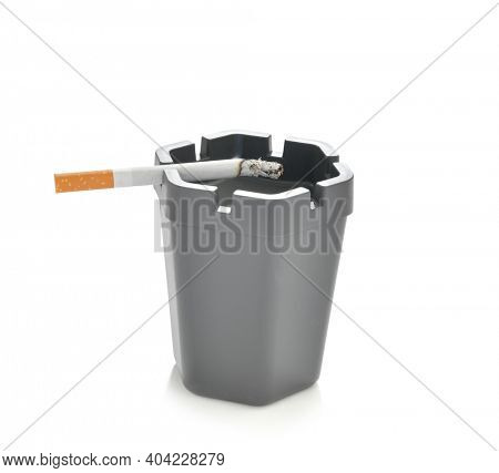 Smoked cigarette butt on ashtray isolated on white background