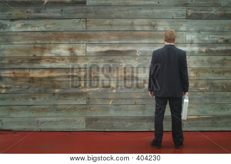 Business Man Facing A Wall