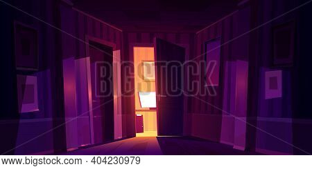Night Home Corridor With Slightly Ajar Door To Room With Computer And Light Falling On Wooden Floor.