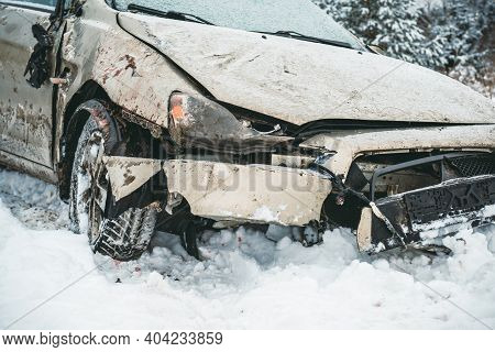 The Car Overturned On A Snowy Road And Got On Its Wheels. A Broken Car After An Accident That Flew O