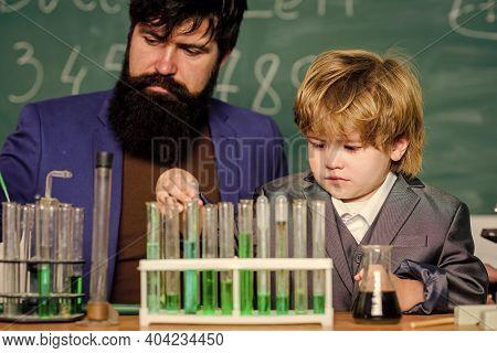 Chemistry Experiment. Teacher Child Test Tubes. Cognitive Process. Kids Cognitive Development. Menta