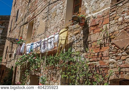 Colle Di Val D'elsa, Italy - May 13, 2013. Old Building With Clothes Hanging To Dry In Colle Di Val