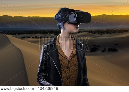 Woman Wearing A Virtual Reality Headset In A Simulated Hiking Experience Through The Desert.  Vr Tou