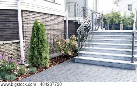 entrance. Iron banister. Elements railing of a beautiful country house, Villa. staircase step with s