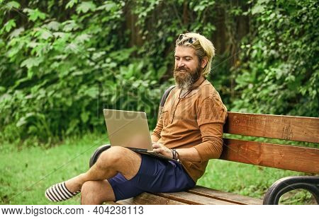 Fresh Air. Mobile Internet. You Can Work Anywhere. Agile Business. Bearded Guy Sit On Bench In Park
