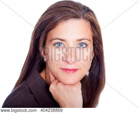 Beautiful woman resting head on hand in a suit