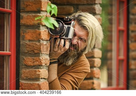Private Detective. Slr Camera. Hipster Man With Beard Use Professional Camera. Photographer Hold Ret