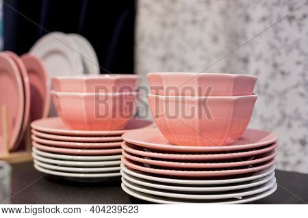 Commercial Pink And White Plates And Bowls Stacked With Crystal Wine Glasses.colorful Ceramic Clean