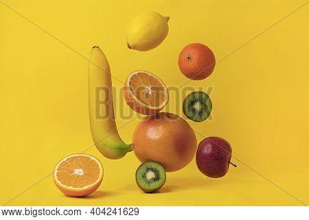 Ripe Bright Fruits Levitating In Space, Banana, Grapefruit, Kiwi, Orange, Lemon, Apple And Tangerine