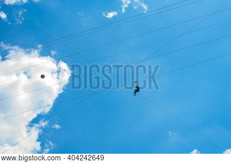 Bukovel, Ukraine - May 27, 2018: Chairlift With Man In Ski Area