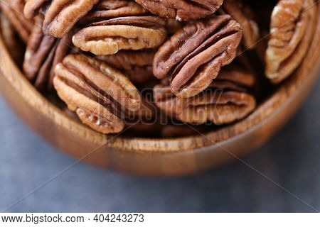Pecan Nut Close-up In A Round Wooden Cup .nuts And Seeds. .healthy Fats.heap Shelled Pecans Nut Clos