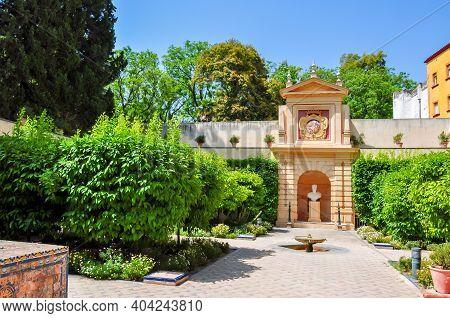 Seville Alcazar Gardens In Andalusia In Summer, Spain